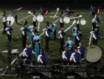 Blue Devils B, percussion, horns, and color guard